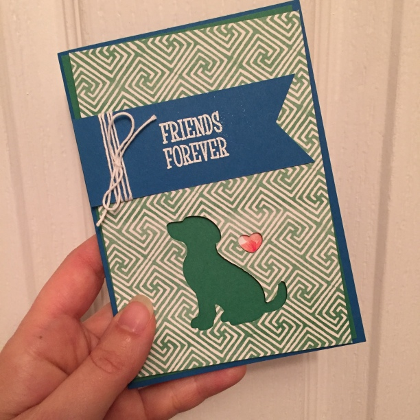 "A green silhouette of a dog on a blue card background with the playful sentiment ""friends forever"""